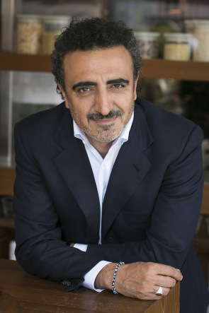 Chobani's founder Hamdi Ulukaya poses at the Chobani Soho cafe on Thursday April 30, 2015 in New York. (Mark Von Holden/AP for Chobani, LLC)